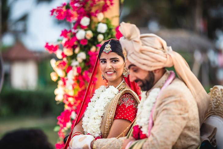 Bride looks at groom during wedding ceremony