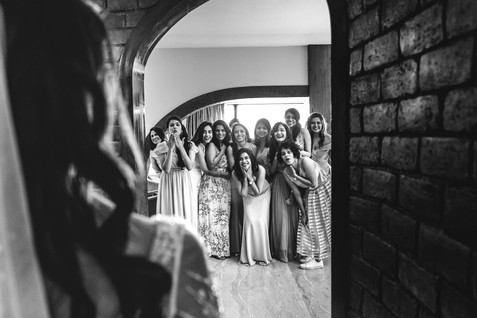 First look of the bride with bridesmaids