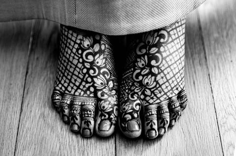 American bride with mehendi on her feet