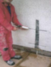 Repairing wall at a Swansea home