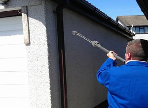 a textured exterior coating on a Port Talbot home