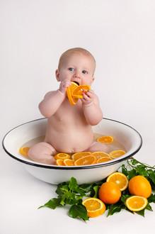 Baby photographer fruit bath in Buckingham Caleb