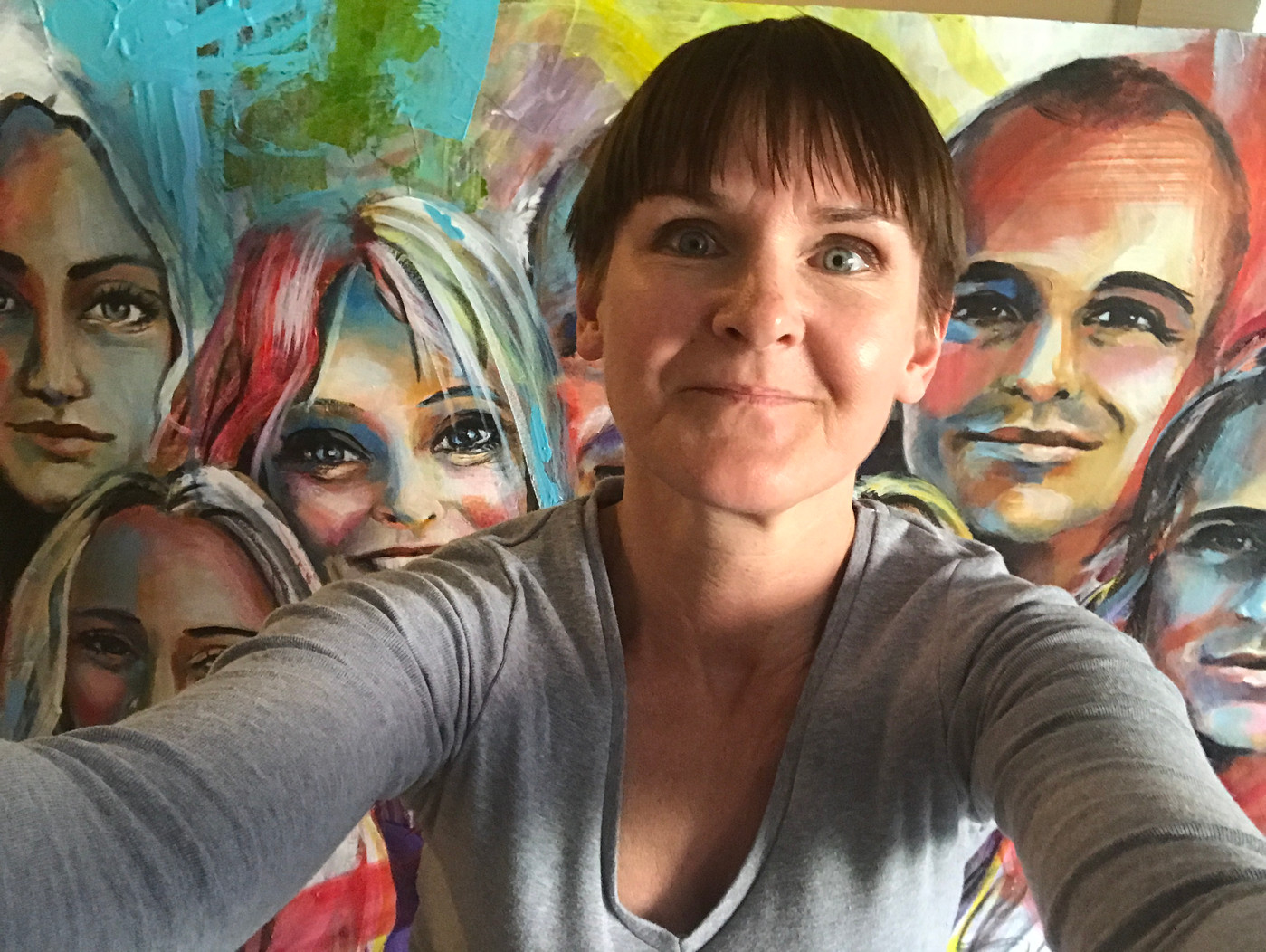 Kicki Edgren in front of a portrait painting