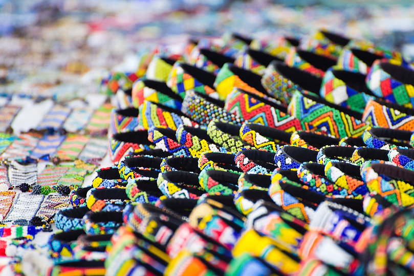 Various colorful bracelets on sale at a