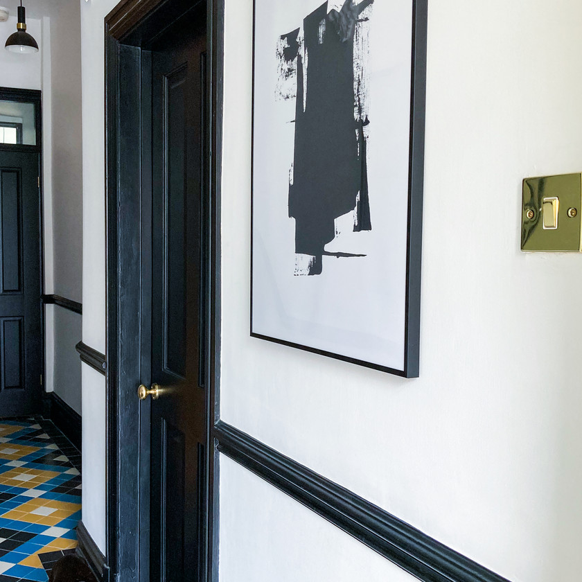 Back and white hallway with ink smudge wall art