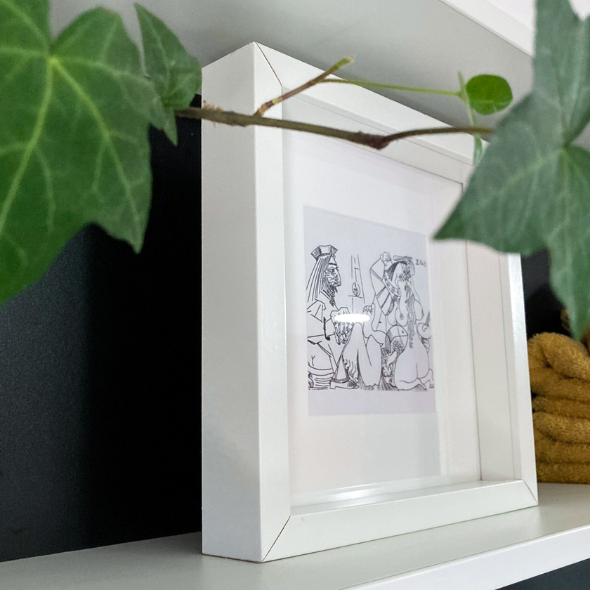 White Square Frame on monochrome shelving unit, with mustard towels