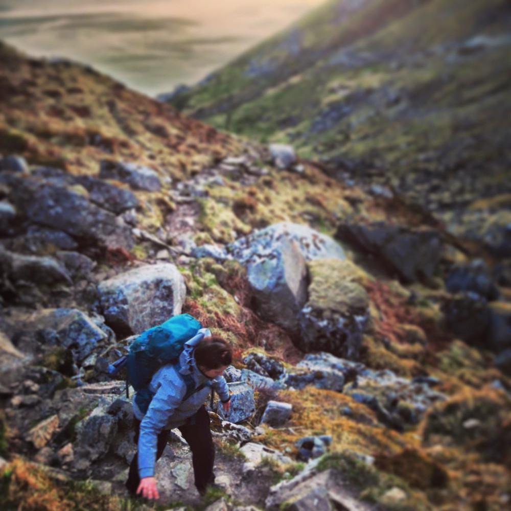 My wife scrambles her way through the rocky terrain on our way to Kvalvika Beach.
