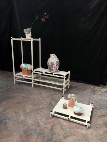 Arrangement for the Simple Task of Relevance Pigmented Plaster, wood, ceramics, flower
