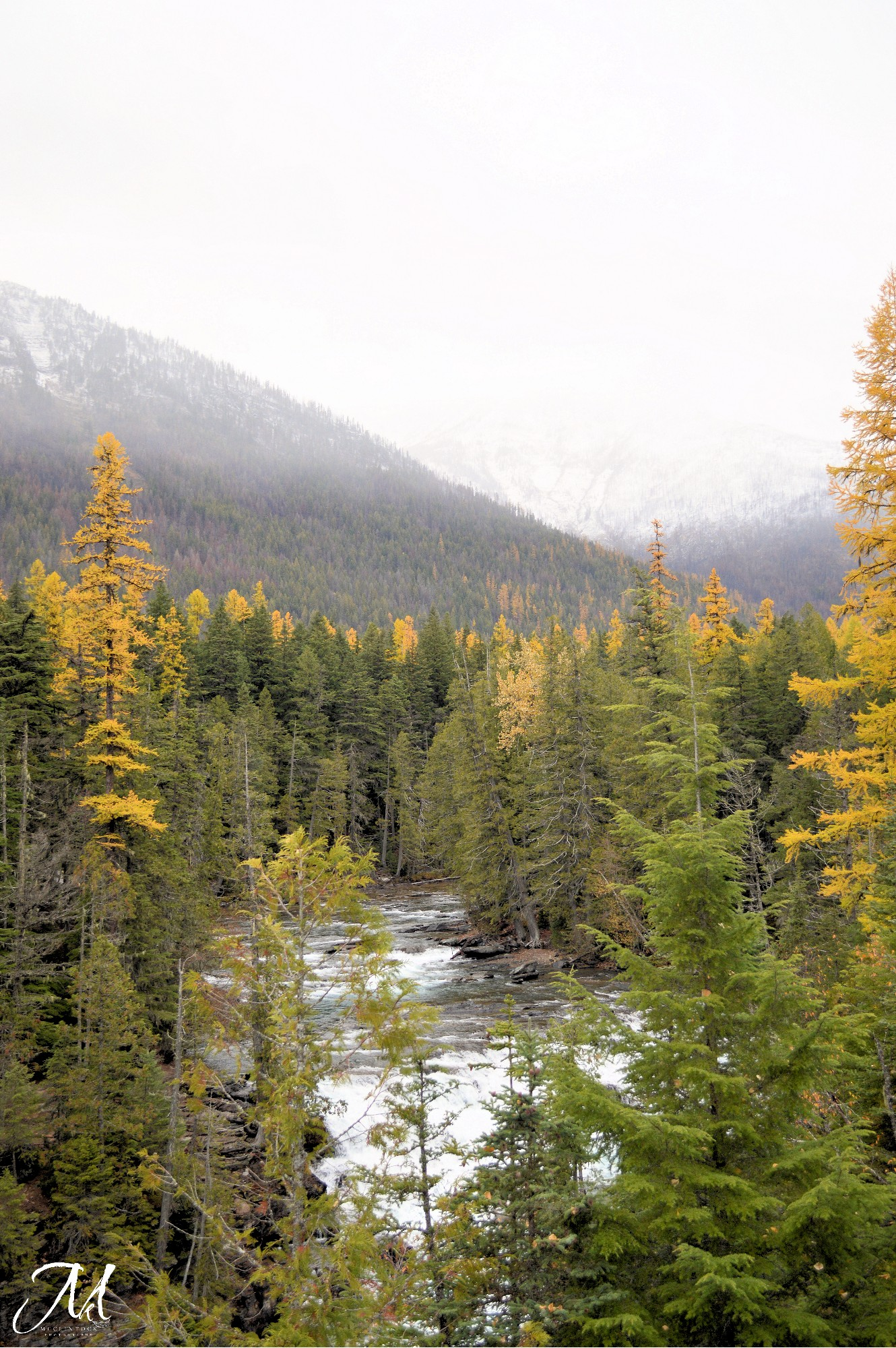 October Mist in Glacier National Park_©MKMcClintock | #Montana #snow #river #waterfall #fall