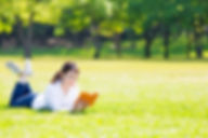 young asian woman reading book in the pa