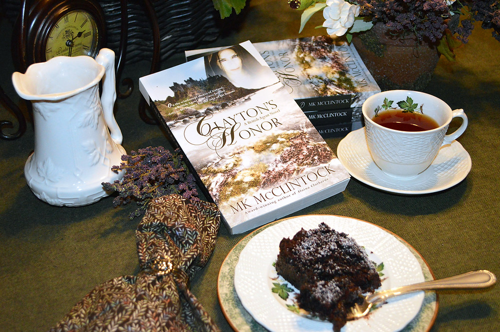Clayton's Honor, a historical romance mystery by MK McClintock, and chocolate cake