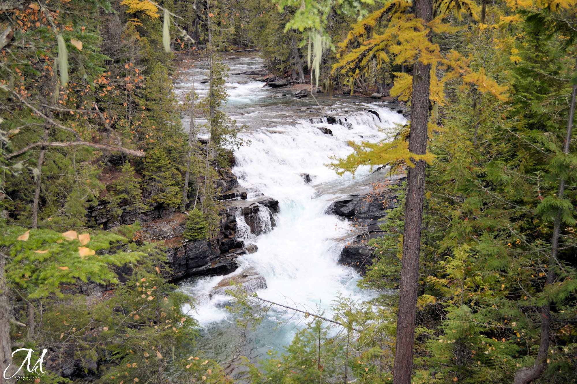 October Mist in Glacier National Park_©MKMcClintock | #Montana #river #waterfall #fall
