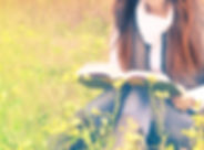 girl reading a book in a meadow_edited.j
