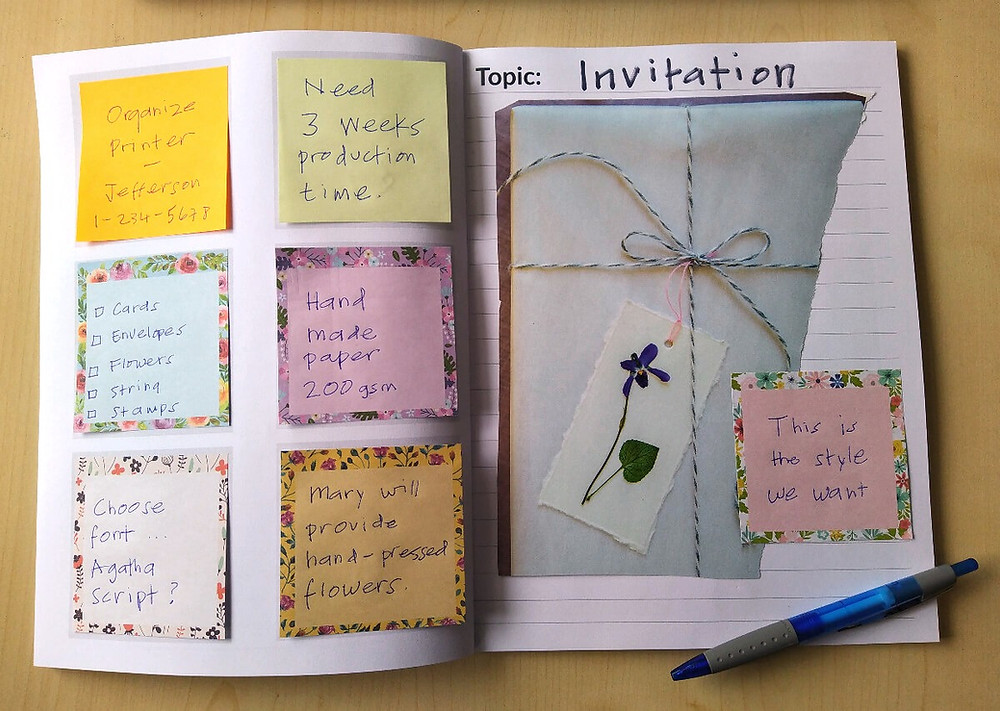 Wedding planner and organizer with sticky Post-It notes.