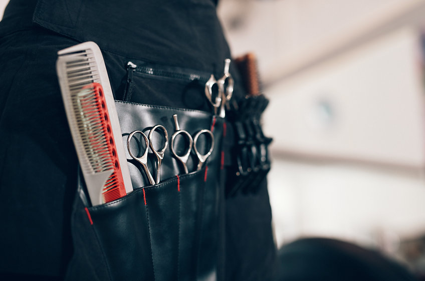 Closeup of scissors and combs in a salon
