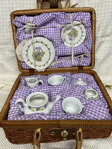 Vintage child's tea set for two in wicker basket