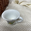 Thumbnail: Vintage child's tea set for two in wicker basket