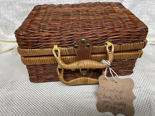 Child's vintage tea set in wicker basket