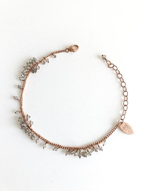 Scattered and row bracelet