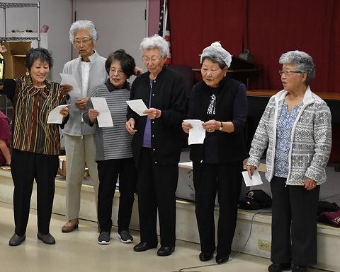 Elderly women singing Buddhist songs