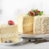 Sliced delicious vanilla cake with fresh