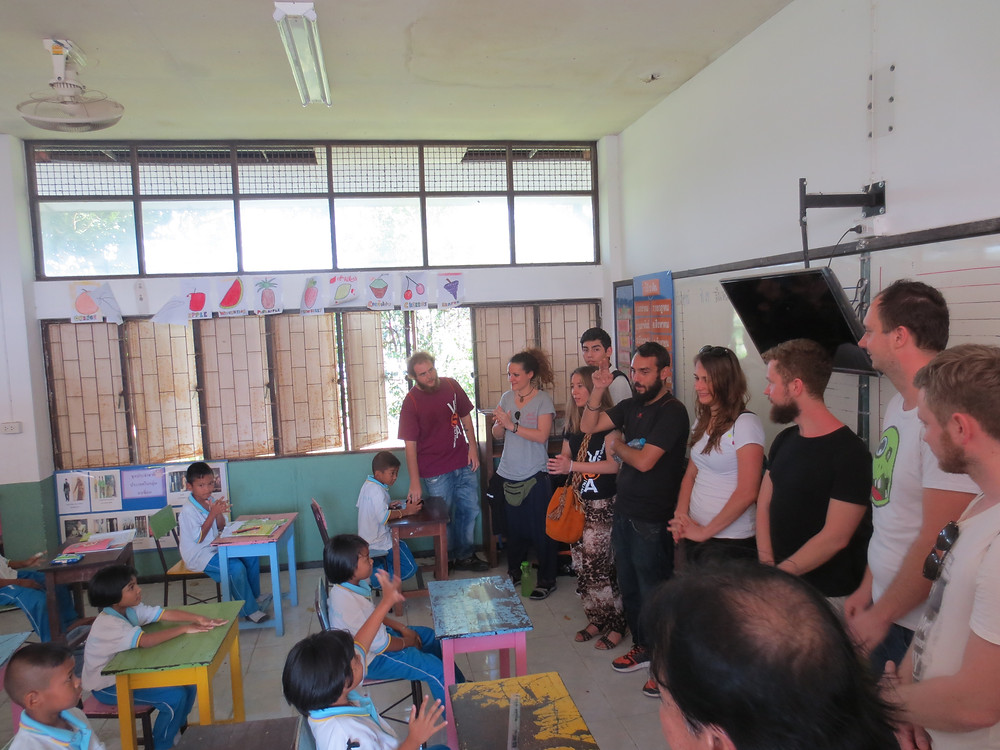 First time in school class, the young European volunteer group stays quiet and shy in front of the children jury. Maybe they will be accepted as futur teacher for few intensive training month.