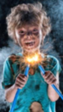 Portrait of crazy little electrician over black background.jpg