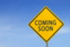Yellow traffic sign _COMING SOON_ on the