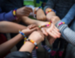 Students making bracelets at Seven Peaks School in Bend, Oregon