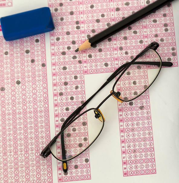 Glasses on an SAT answer key