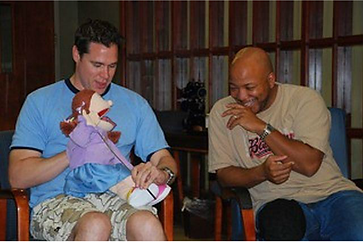 Keith and Joel puppet laughing picture in OTC improv class