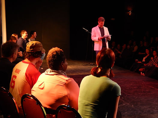 Paul on stage duing OTC improv show