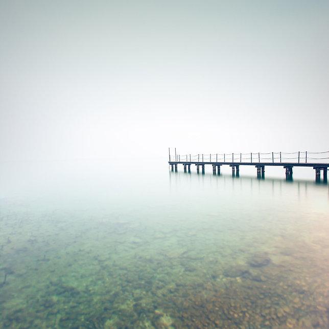 Hard to see foggy landscape.