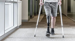 Individual with Prosthetic Leg Using Crutches