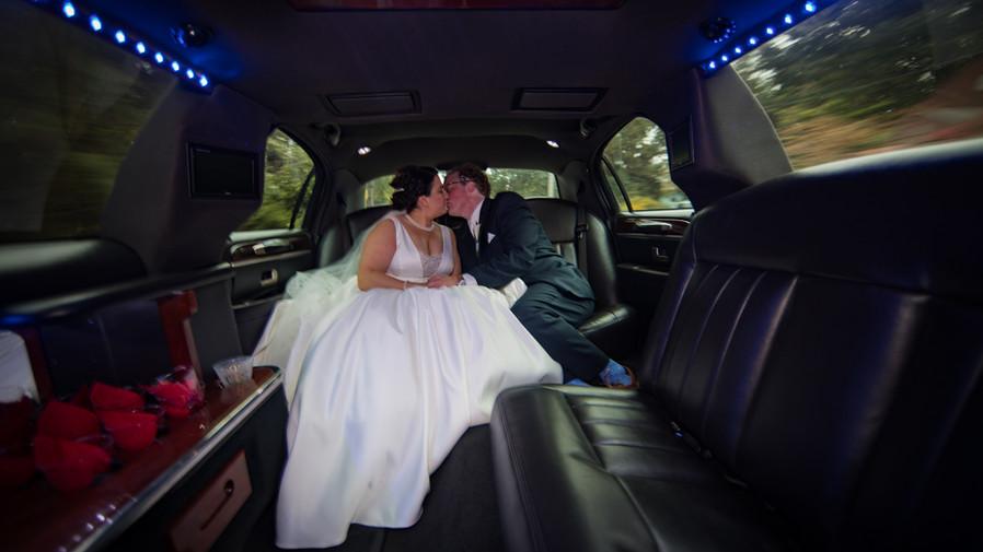 Wedding day limo rides make for some cool wedding photos!
