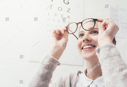 stock-photo-happy-young-woman-trying-her-new-glasses-eye-care-concept-627150041