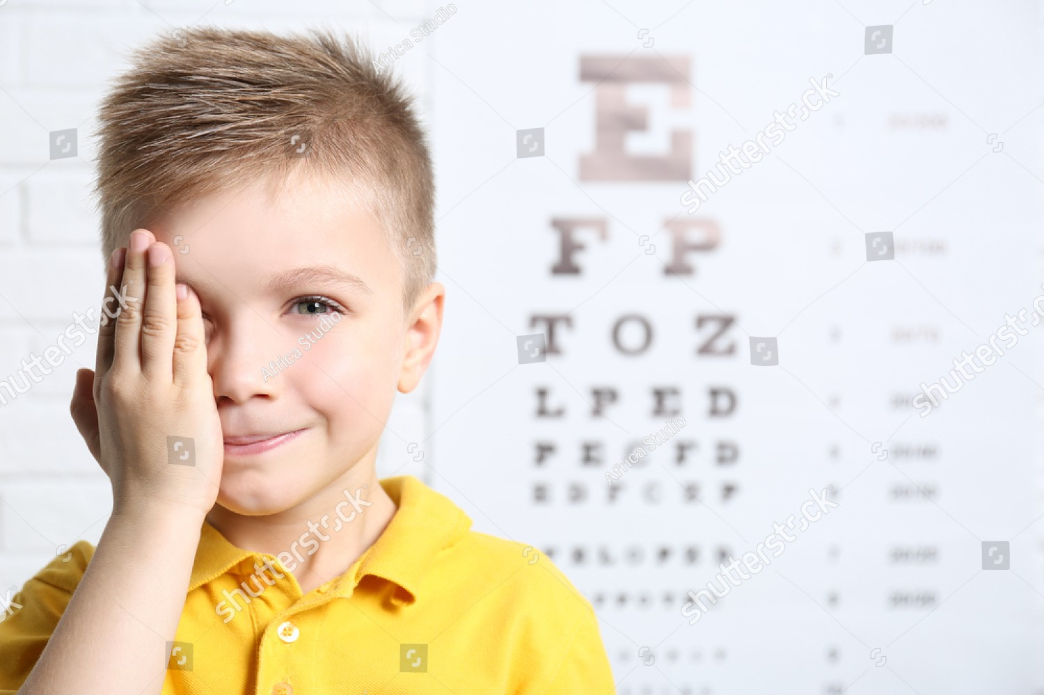 stock-photo-little-boy-having-eye-test-at-ophthalmologist-office-568229614