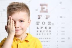 stock-photo-little-boy-having-eye-test-at-ophthalmologist-office-568229614