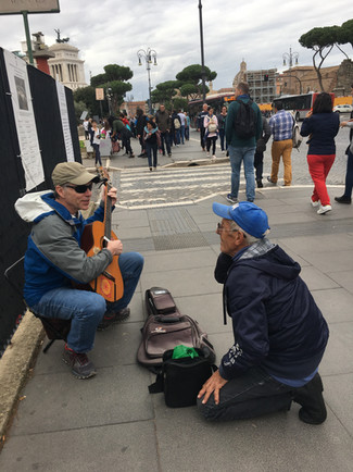 Rich performing on the streets of Italy.