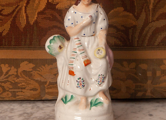 A Victorian Staffordshire Figure of a Young Lady with a Nest