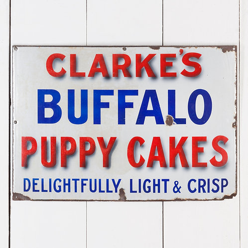 CLARKE'S BUFFALO PUPPY CAKES ENAMEL SIGN