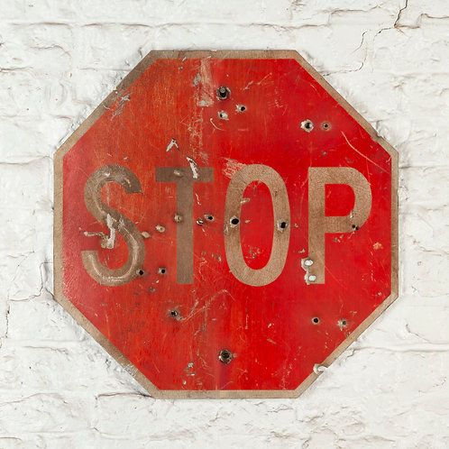 VINTAGE AMERICAN STOP ROAD SIGN WITH BULLET HOLES