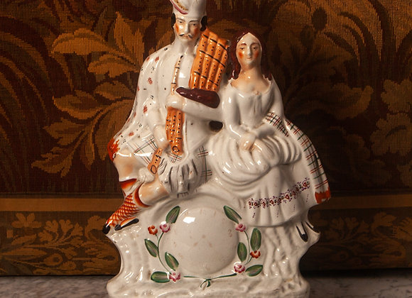 A Large Victorian Staffordshire Flatback Group of a Scottish Couple