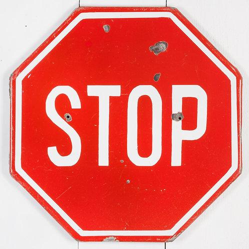 A VIBRANT, VINTAGE ENAMEL STOP SIGN