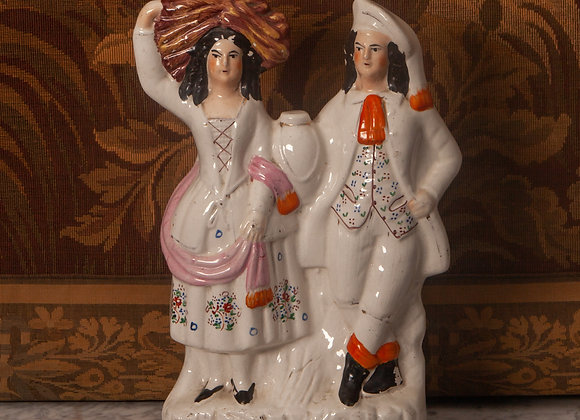 A Victorian Staffordshire Flatback Figure of a Man and Woman