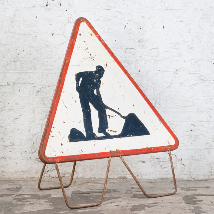 AN EARLY ROADWORKS SIGN