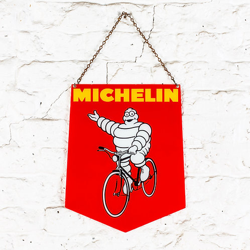 A GLASS MICHELIN CYCLES SHIELD SHAPED SIGN