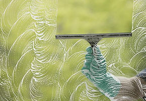 glass cleaning with squeegee