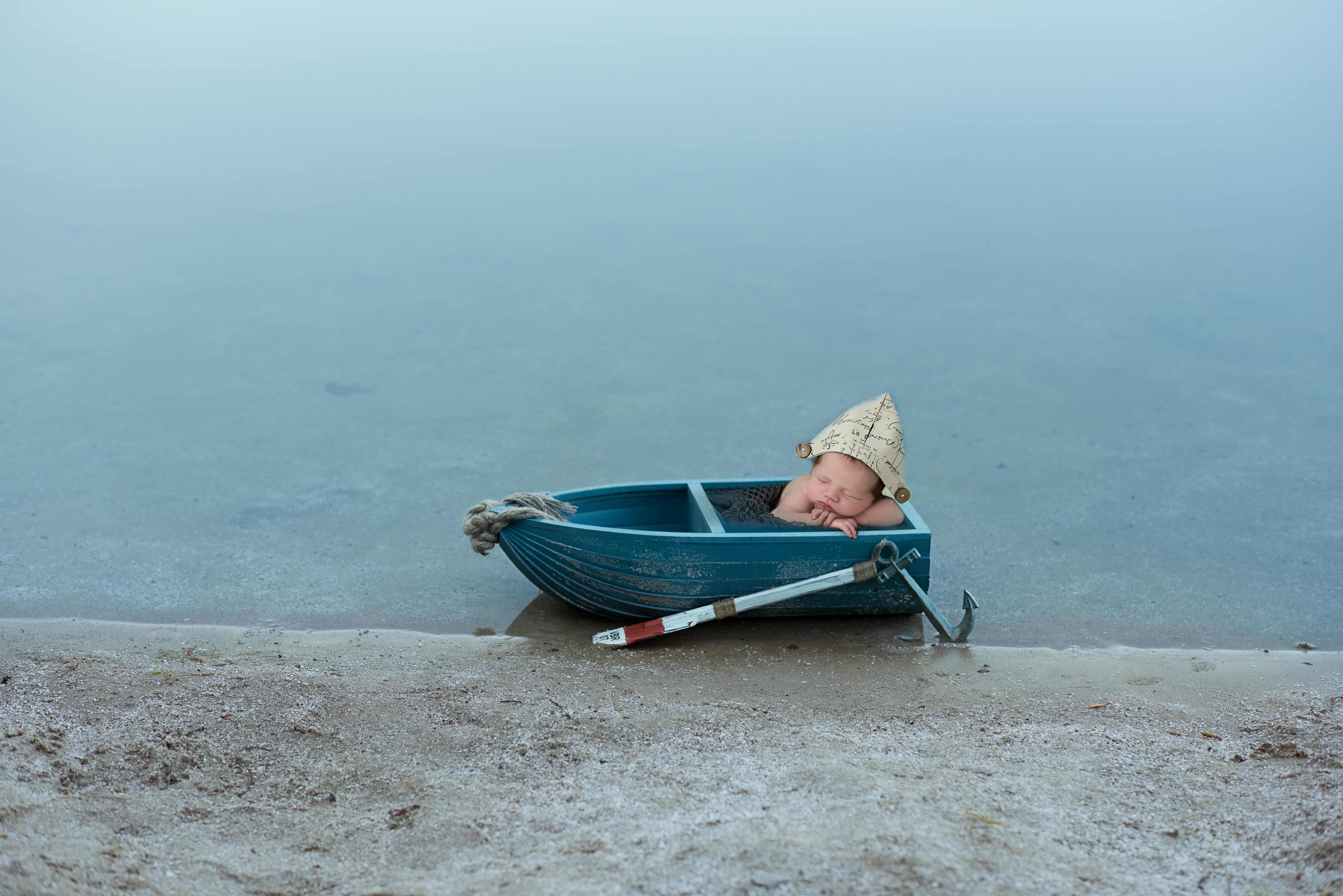 newborn in a boat