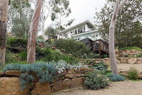 shutterstock_493403083 - House in bushla